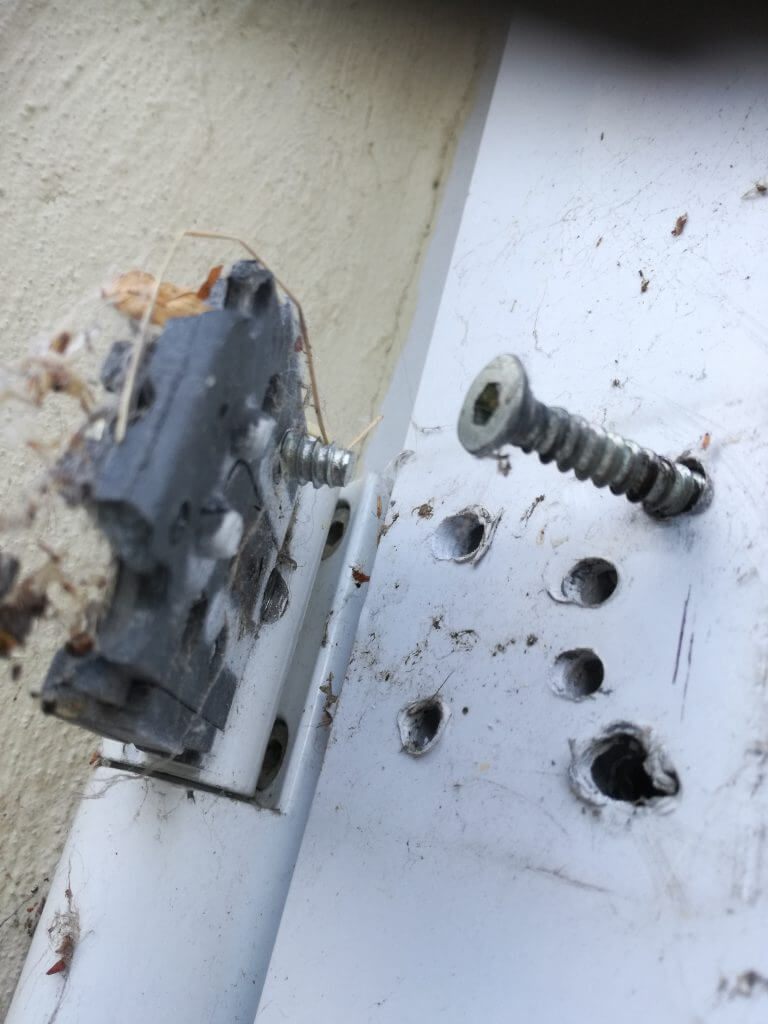 Broken UPVC door hinge